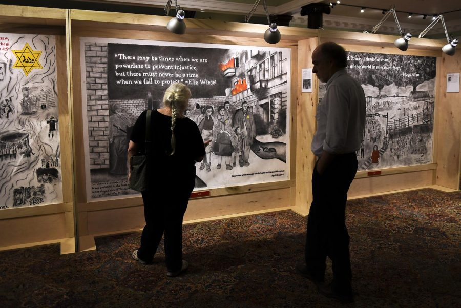 Libby Davies, left, and WKU English professor Lloyd Davies, right, view murals in the
