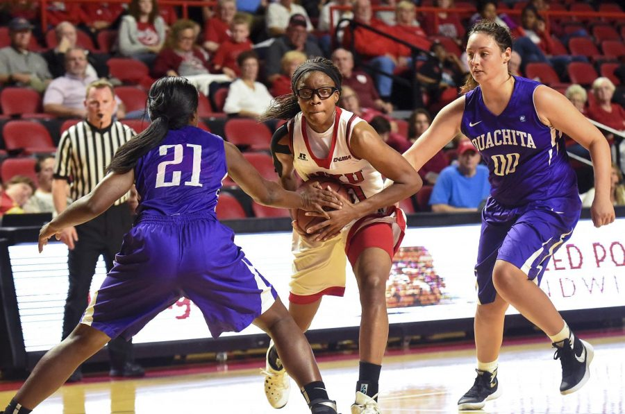 Sophomore forward Tashia Brown (10) tries to get past the defense during the Lady Toppers' 108-43 win over Ouachita Baptist University on Tuesday at Diddle Arena. Matt Lunsford/HERALD