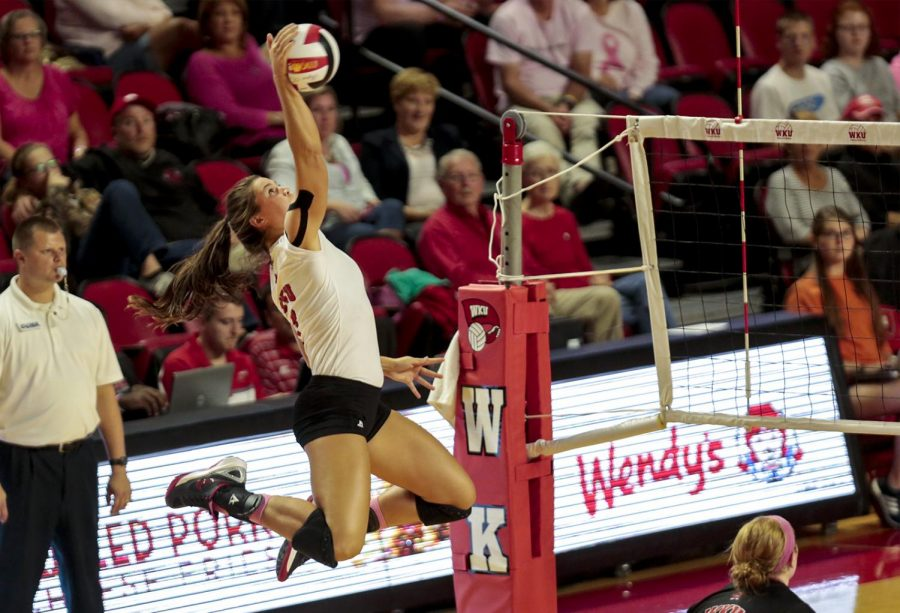 WKU%27s+outside+hitter+Alyssa+Cavanaugh+%287%29+spikes+the+ball+towards+UTSA+during+the+final+set+of+the+Lady+Toppers%27+3-1+win+Friday+at+E.A.+Diddle+Arena.