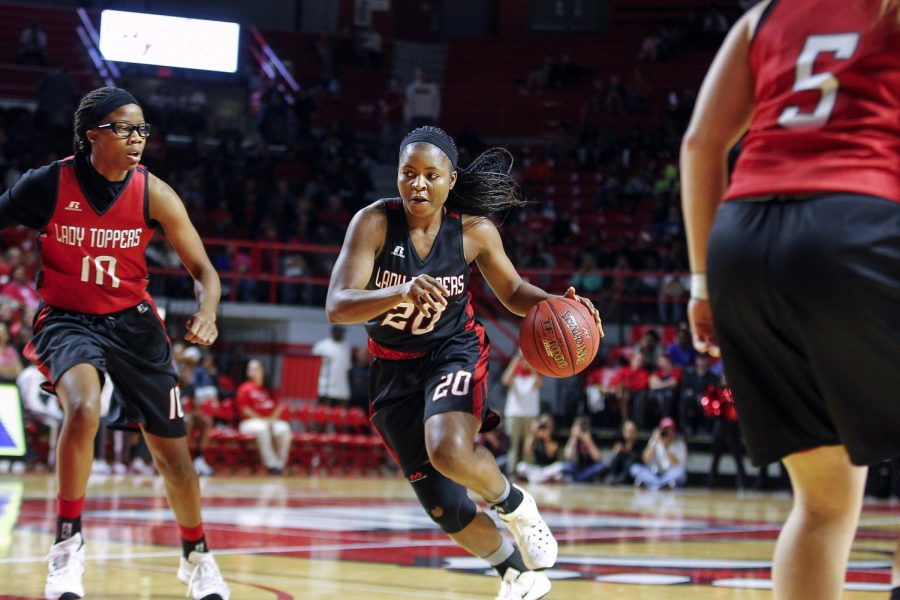 Lady Topper junior guard Ima Akpan (20), dribbles past sophomore forward Tashia Brown (10) during a scrimmage game in Diddle Arena. Alyssa Pointer/HERALD