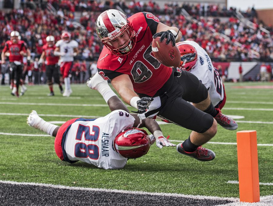 Redshirt+senior+Tim+Gorski+%2886%29+gets+past+Florida+Atlantic%27s+linebacker+Azeez+Al-Shaair+%2828%29+to+score+a+touchdown+during+the+Hilltoppers%27+35-19+win+on+Nov.+11+at+Smith+Stadium.+Nick+Wagner%2FHERALD