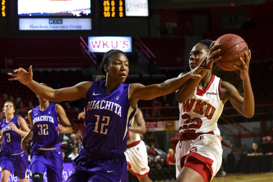 WKUs guard Kayla Smith (32), heads to the hoop for two of her 17 points during the Lady Hilltoppers 108-43 win over Ouachita Baptist University on Tuesday at Diddle Arena.
