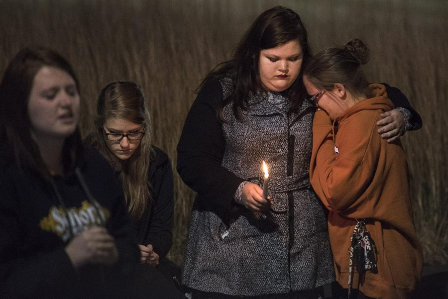 A crowd gathered outside of Pearce Ford Tower for a candle light vigil, to remember a student that died in PFT, Sunday, Nov. 15. Over 150 students, staff and community members attended the vigil. Nick Wagner/HERALD