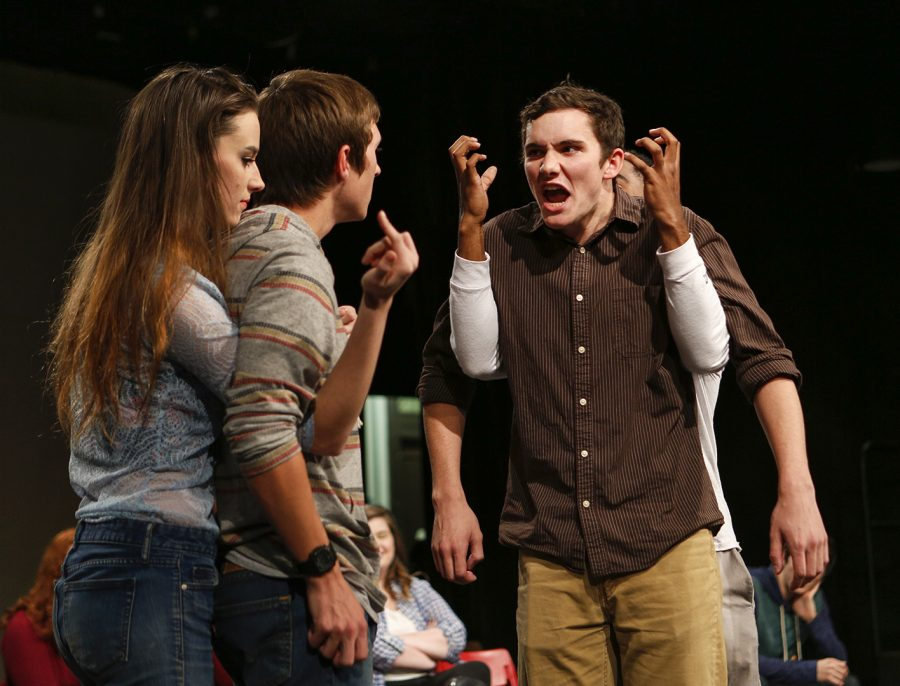 From left: Junior Jubilee Sneed from Glasgow, sophomore Morgan Stevens from Somerset, junior Ethan Corder from Charlestown, Ind., and sophomore Ethan Mitchell from Hendersonville, Tenn., play a game in which Sneed and Mitchell perform hand gestures for Stevens and Corder on Saturday in Gordon Wilson Hall. The game was part of the Happy Gas Improv special performance in honor of Ryan Kemp, a member who recently passed away.
