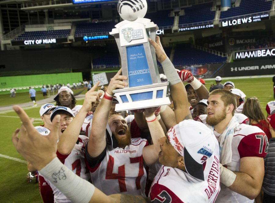 December 21, 2015: Western Kentucky players hoist the championship trophy after the Miami Beach Bowl at Marlins Park in Miami, Florida, on Monday, Dec. 21, 2015. Western Kentucky beat South Florida 45-35. Nick Wagner/HERALD