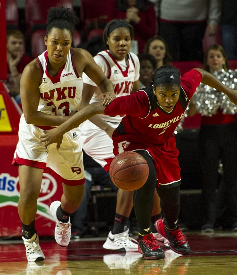 WKU%27s+forward+Jalynn+McClain+%2833%29+and+Louisville+forward+Myisha+Hines-Allen+%282%29+eye+a+loose+basketball+during+the+Lady+Topper%27s+71-69+win+Saturday+at+E.A.+Diddle+Arena.