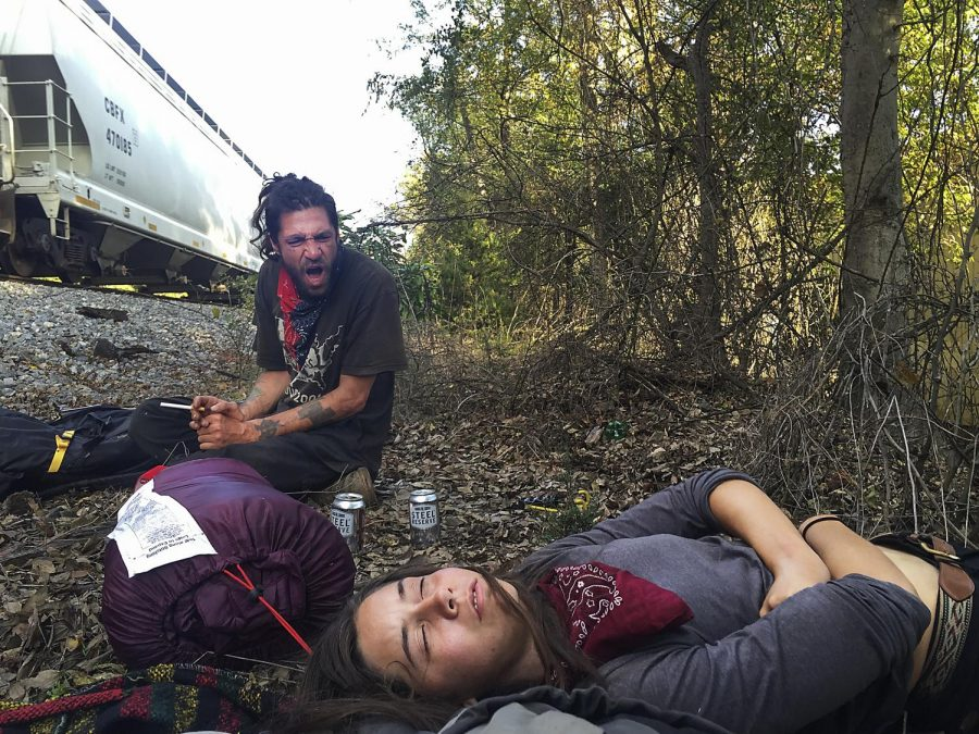 Matt+Smerph+Johnson%2C+left%2C+yells+to+wake+up+Bambi%2C%E2%80%9D+right%2C+passed+out+from+drinking+too+much%2C+as+a+train+to+New+Orleans+passes+by.+The+duo+missed+the+train+and+instead+hopped+to+Boligee%2C+Alabama.+Homefree+travelers+rely+on+train+hopping%2C+hitchhiking%2C+rubber+tramping+and+traveling+by+car+to+journey+to+destinations.+Emily+Kask%2FSPECIAL+TO+THE+HERALD