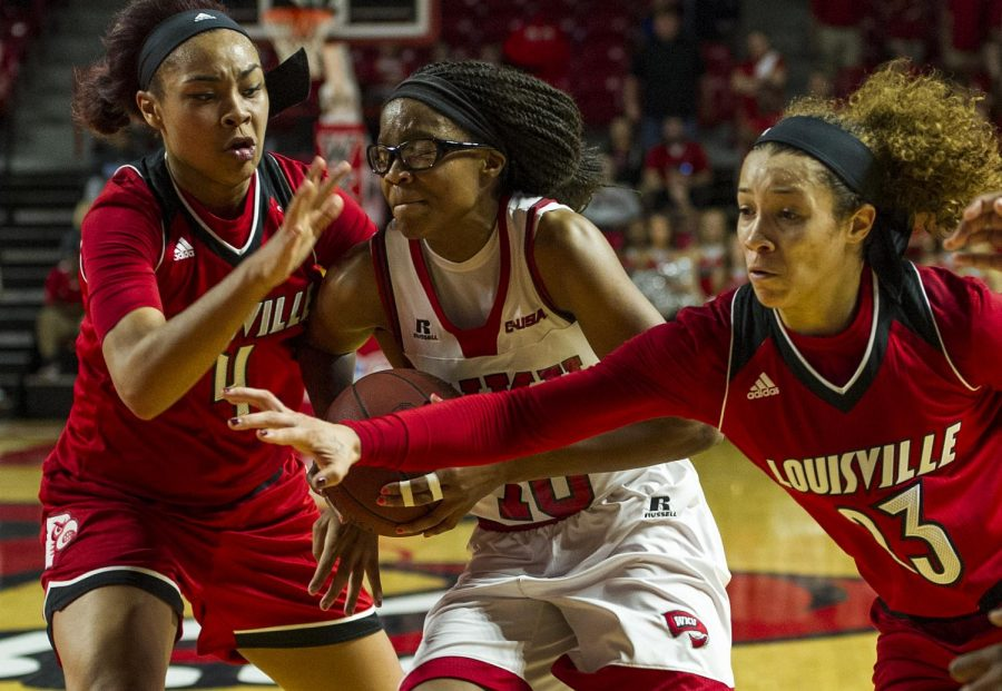 WKUs forward Tashia Brown (10) drives to the basket against Louisville forward Mariya Moore (4) and guard Briahanna Jackson (23) during the Lady Toppers 71-69 win Saturday at E.A. Diddle Arena.