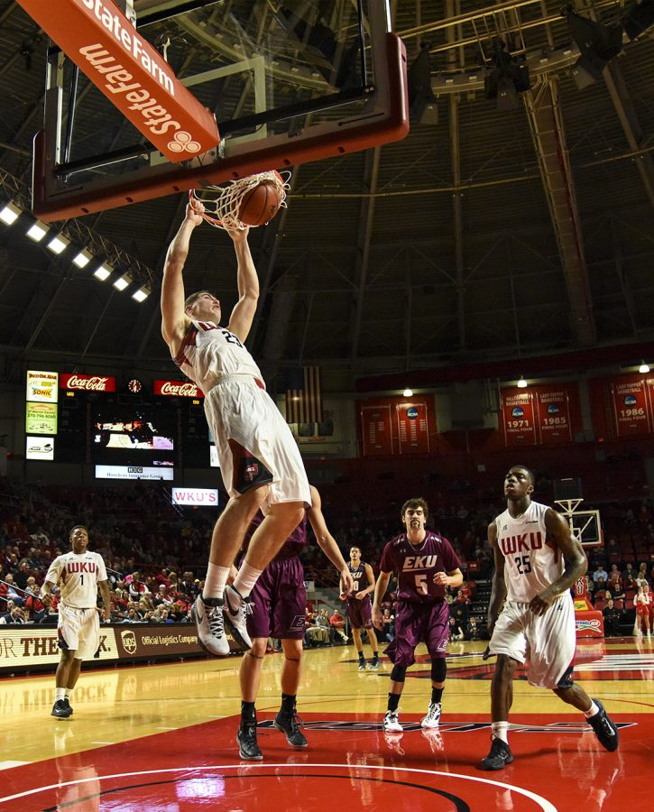 WKUs forward Justin Johnson (23) dunks the ball during the Hilltoppers 86-84 win over Eastern Kentucky University on Tuesday at Diddle Arena.