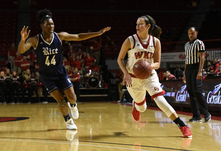 Redshirt junior guard Kendall Noble drives the ball down the court just ahead of Rice player Adaeze Obinnah during WKU's game against the Owls on Jan. 15. Jennifer King/HERALD