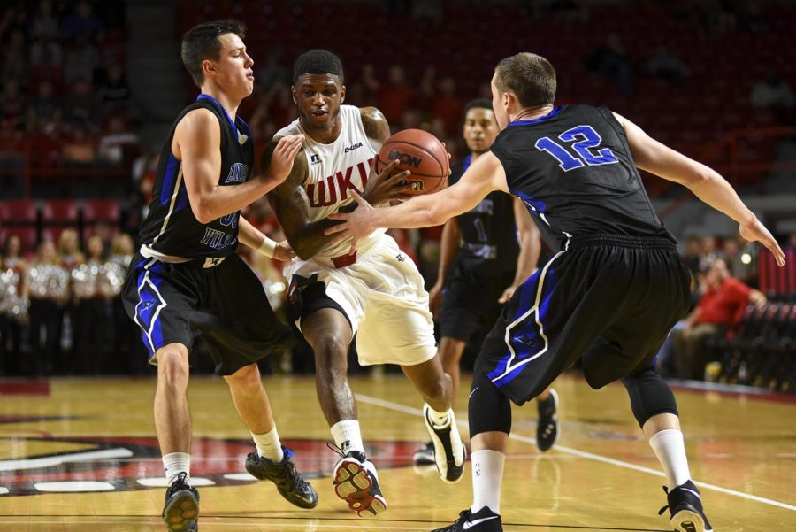 WKUs guard Aaron Cosby (2) drives towards the basket during the Hilltoppers 84-71 win over Lindsey Wilson College on Monday at Diddle Arena.