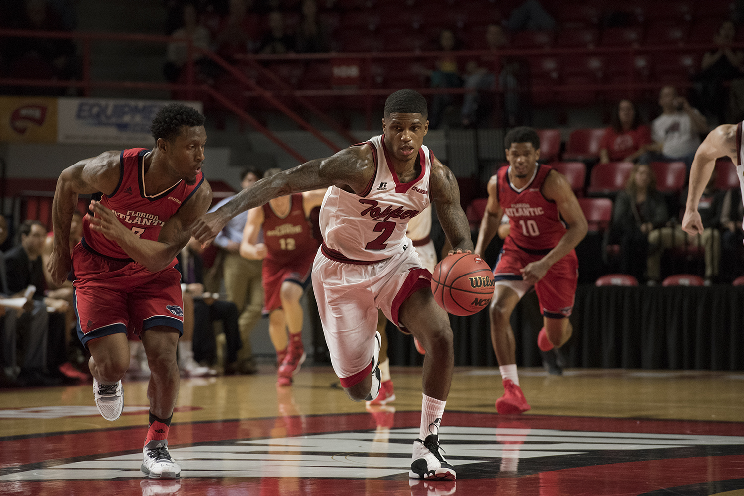 Redshirt senior guard Aaron Cosby drives the ball down the court after stealing it from Florida Atlantic junior Adonis Filer during the second half of WKUs game against the Owls on Saturday. Cosby scored 17 points on the day. Jennifer King/HERALD