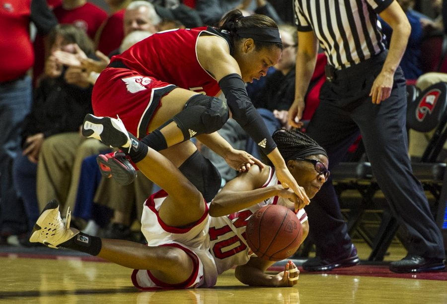 WKU's forward Tashia Brown (10) beats Louisville forward Myisha Hines-Allen (2) to the ball in the final seconds of the Lady Topper's 71-69 win Saturday at E.A. Diddle Arena.