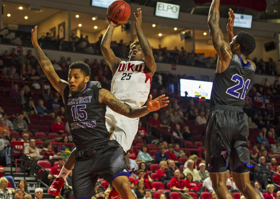 Western Kentuckys Fredrick Edmond (25) puts up a shot amid two Kentucky Wesleyan defenders during Fridays game at E.A. Diddle Arena. The Hilltoppers won the homecoming game 75-68. Nick Wagner/HERALD
