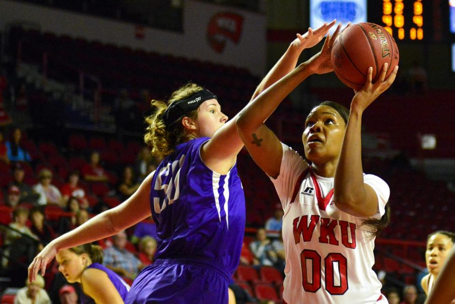 WKU's forward Simone Goods (00), heads to the hoop for two of her six points during the Lady Hilltopper's 108-43 win over Ouachita Baptist University on Tuesday at Diddle Arena.