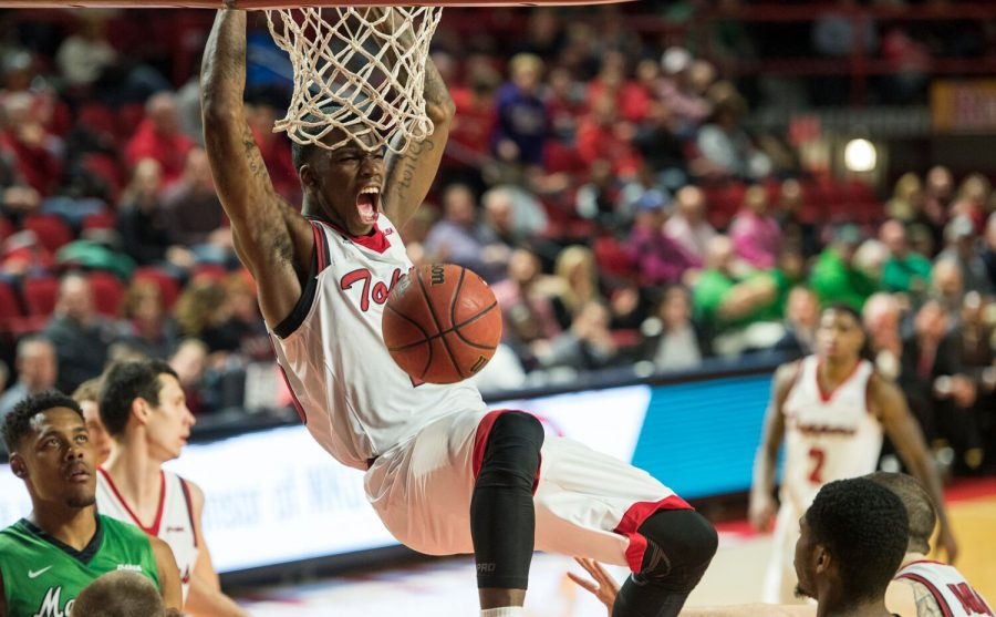 WKU guard Fredrick Edmond (25) screams after a slam dunk during overtime of an NCAA college basketball game against Marshall at Diddle Arena in Bowling Green, Kentucky, on Saturday, Feb. 13, 2016. Nick Wagner/HERALD