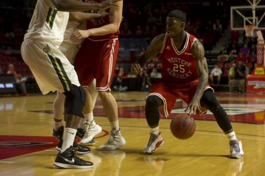WKU+junior+guard+Fredrick+Edmond+%2825%29+slips+around+a+screen+on+his+way+to+the+hoop.+Edmond+had+nine+points%2C+four+rebounds%2C+and+two+steals+during+the+game+against+Charlotte.+WKU+defeated+Charlotte%2C+59+-+54.+Western+Kentucky+University+Mens+Basketball+team+takes+on+the+University+of+Charlotte+49ers+at+Diddle+Arena+on+Feb.+20%2C+2016%2C+in+Bowling+Green%2C+Ky.+Matt+Lunsford%2FHERALD
