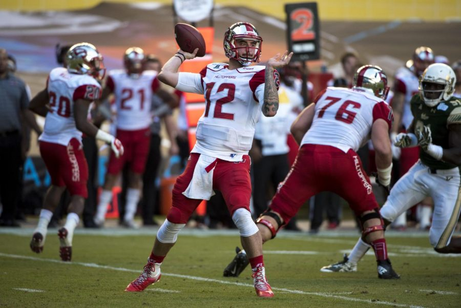 WKU%27s+quarterback+Brandon+Doughty+%2812%29+passes+during+the+first+half+of+the+Miami+Beach+Bowl+between+WKU+and+the+University+of+South+Florida+Monday+at+Marlins+Park+in+Miami%2C+Fl.+Mike+Clark%2FHERALD