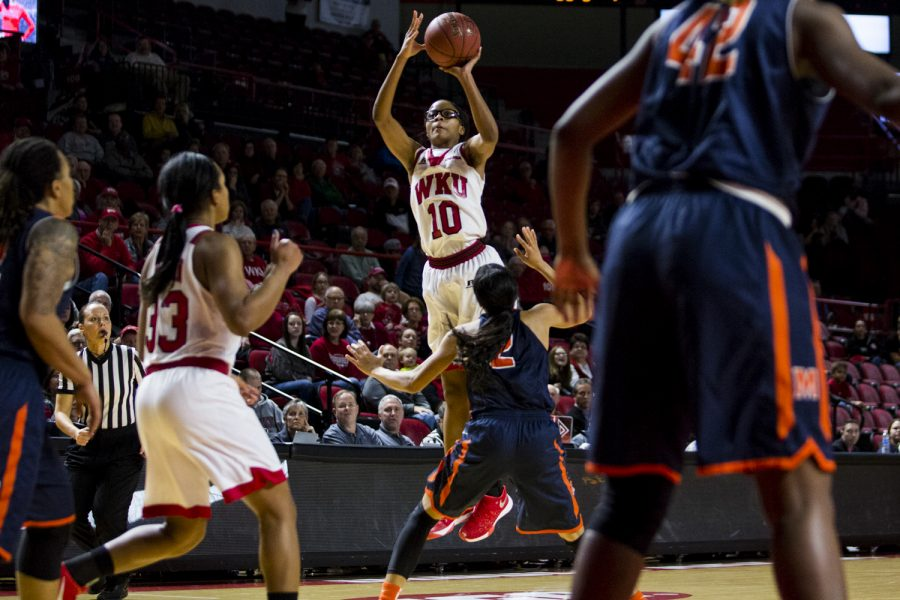 WKU's forward Tashia Brown (10) goes for a jump shot over University of Texas at El Paso guard Cameasha Turner (2) during the Lady Toppers' 85-78 loss to University of Texas at El Paso on Saturday Feb. 6 at E.A, Diddle Arena in Bowling Green, Ky. Brown went for 11-17 in field goals. Shaban Athuman/HERALD