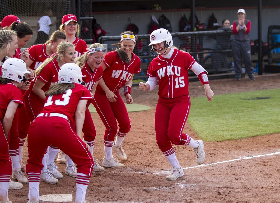 The Lady Toppers cheer as outfielder Kelsey McGuffin (15) reaches home plate after hitting a two-run homer during the Lady Topper's 5-0 win over Austin Peay in the Holiday Inn Hilltopper Classic on Saturday, Feb. 20, 2016 at the WKU softball field. Mike Clark/HERALD