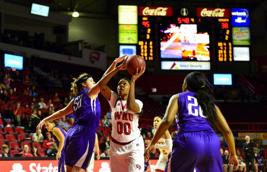 WKU%27s+forward+Simone+Goods+%2800%29%2C+heads+to+the+hoop+for+two+of+her+six+points+during+the+Lady+Hilltopper%27s+108-43+win+over+Ouachita+Baptist+University+on+Nov.+3%2C+2015+at+Diddle+Arena.