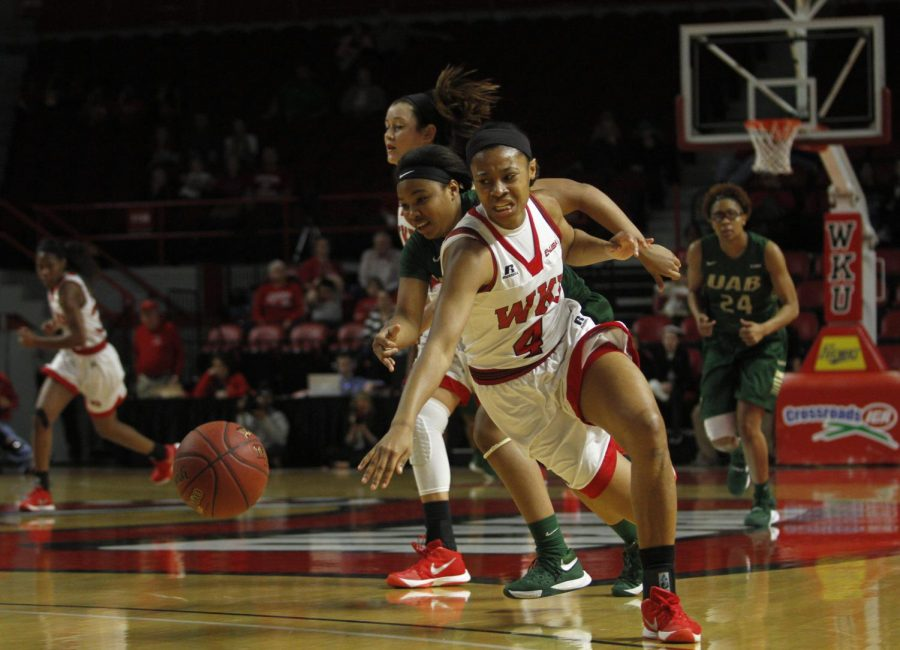 Freshman forward Dee Givens (4) steals the ball during the first half of the WKU vs. University of Alabama, Birmingham game on Saturday, Feb. 27 at Diddle Arena. Ebony Cox/HERALD
