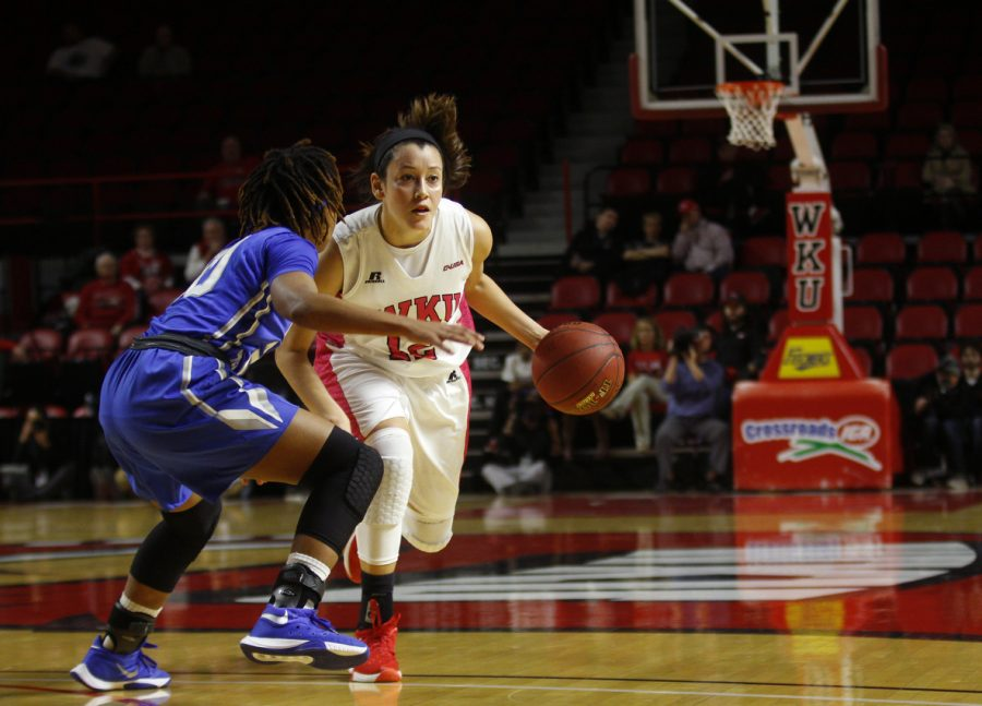 WKU guard Kendall Noble (12) dribbles past the defense during the first half of the lady Toppers 32-30 lead over MTSU at E.A. Diddle Arena.Kathryn Ziesig/HERALD