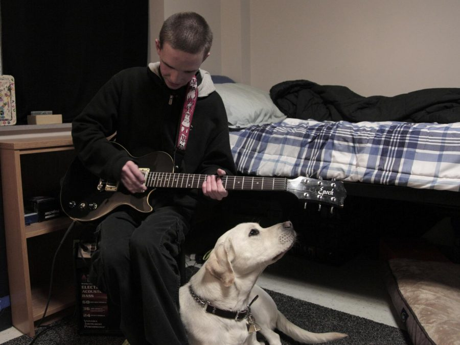 Chuck Winstead, a freshman from Owensboro, is studying mechanical engineering. He and his dog Puck can be regularly spotted around campus or found relaxing in his dorm room playing guitar. Winstead has had two leader dogs since he has been on campus, a black lab named Topper and a yellow lab named Puck, which make his travels around campus much easier. Lex Selig/HERALD