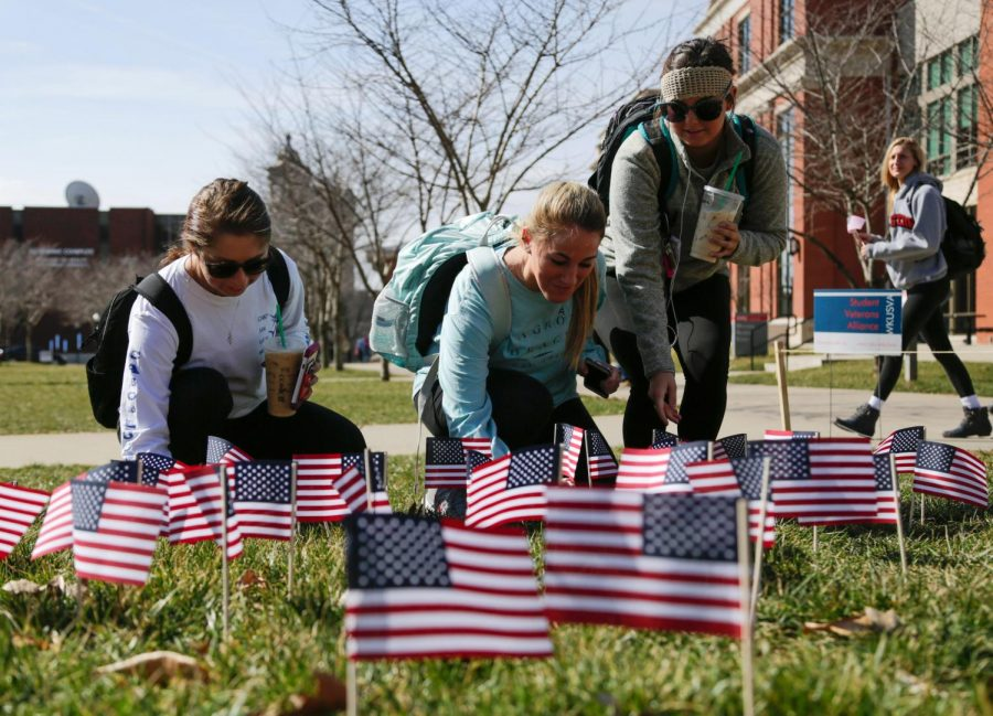 Brentwood%2C+Tennessee+freshman+Presley+Hill%2C+Shelbyville+freshman+Mackenna+Montfort+and+Brentwood%2C+Tennessee+freshman+Megan+Derrington+plant+flags+to+pay+tribute+to+veterans+on+campus+on+their+way+to+class+on+Tuesday%2C+Feb.+23.+Srijita+Chattopadhyay%2FHERALD