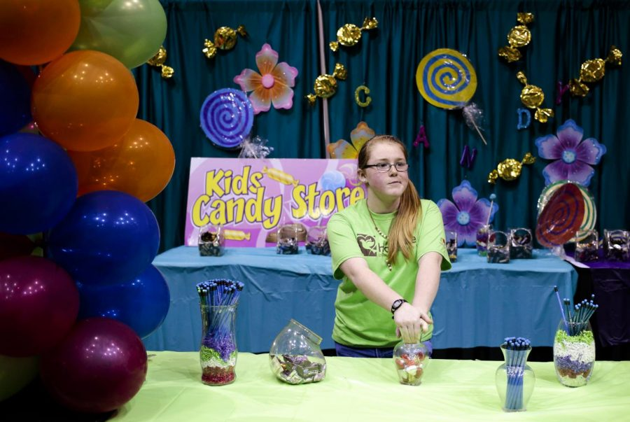 Near the end of the event, Ann-Riley Cox, 13, waits for visitors at the Kids Candy Store booth at the Chocolate Festival on Sunday at the Sloan Convention Center. Proceeds from the ticket sales benefit the Hospice of Southern Kentucky. Leanora Benkato/Herald