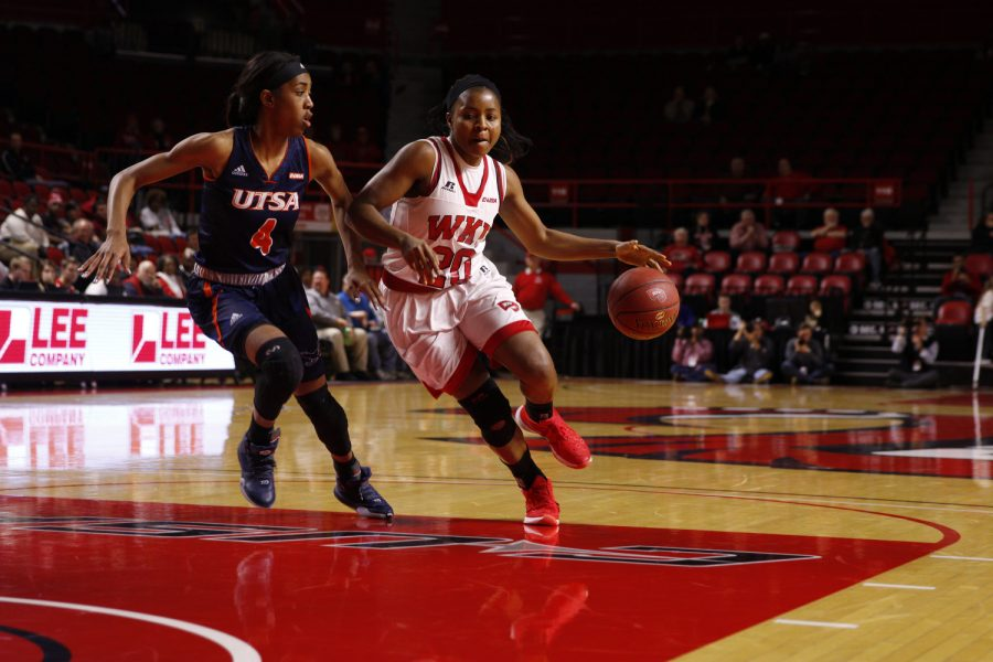 WKU%27s+guard+Ima+Akpan+%2820%29+dribbles+around+University+of+Texas+at+San+Antonio+guard+Crystal+Chidomere+%284%29+during+a+WKU-University+of+Texas+at+San+Antonio+basketball+game+on+Thursday+Feb.+4+at+E.A.+Diddle+Arena+in+Bowling+Green%2C+Ky.+Kathryn+Ziesig%2FHERALD