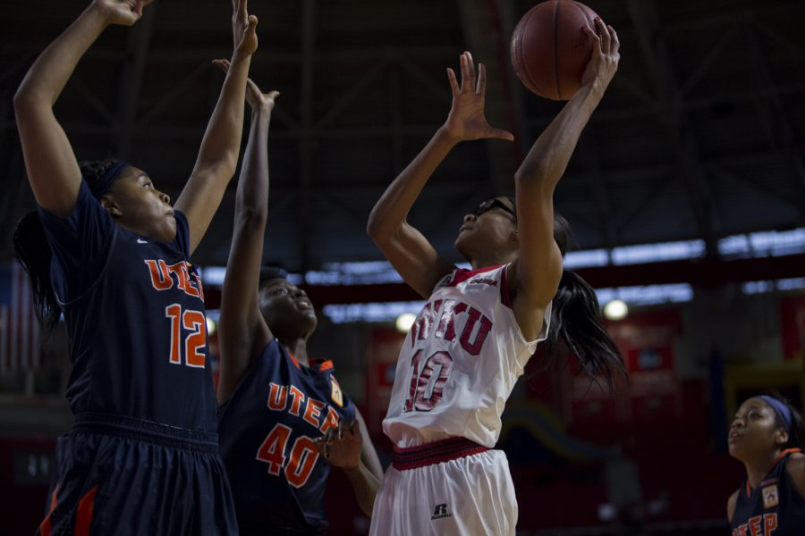 WKU's forward Tashia Brown (10) shoots over University of Texas at El Paso guard Sparkle Taylor (12) and Tamara Seda (42) during a WKU-University of Texas at El Paso basketball game on Saturday Feb. 6 at E.A, Diddle Arena in Bowling Green, Ky. Shaban Athuman/HERALD