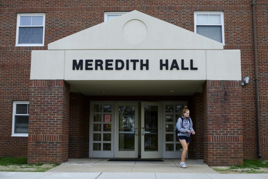 A+student+leaves+Meredith+Hall+Thursday+morning%2C+March+24.+Three+sororities+have+their+own+floor+in+the+building.+Abby+Potter%2FHERALD