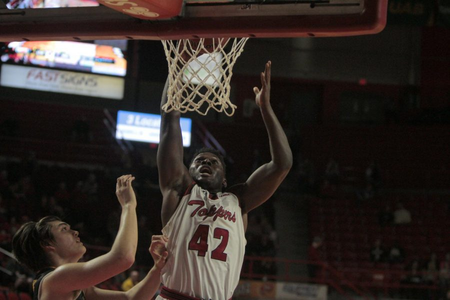 Junior forward Anton Waters (42) dunks the ball during the WKU USM game on Thursday in Diddle Arena. Hilltoppers won 75-60 and Waters ended the night with three rebounds and four points. Ebony Cox/HERALD