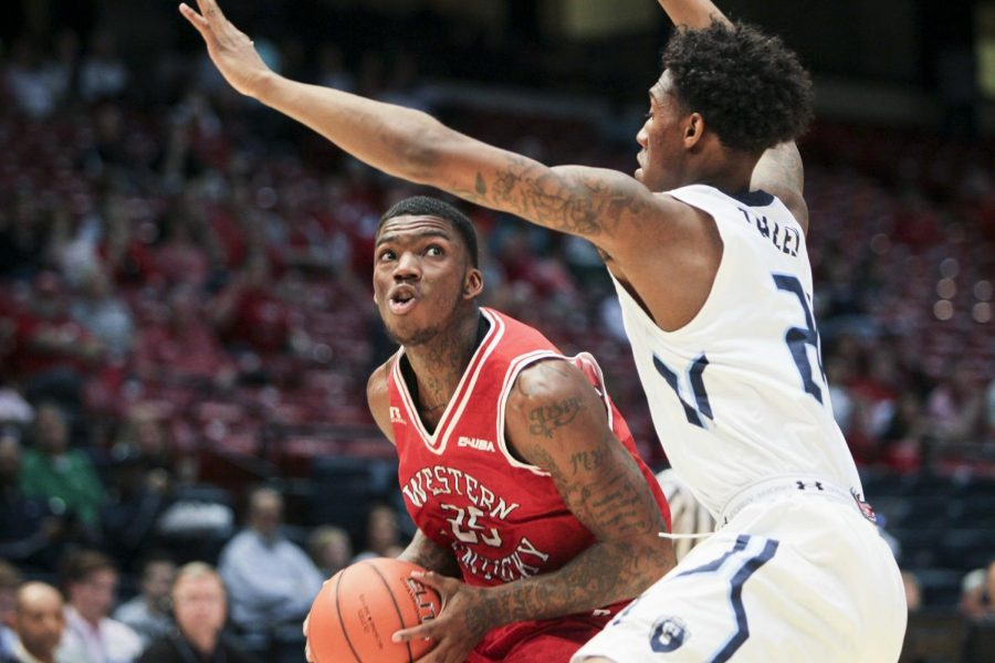 Western+Kentucky+Hilltoppers+guard+Fredrick+Edmond+%2825%29+is+carefully+guarded+by+Old+Dominion+Monarchs+forward+Zoran+Talley+%2824%29+as+he+drives+for+a+basket.+WKU+leads+the+Monarchs+35-32+at+the+half%2C+during+the+semifinals+of+the+C-USA+tournament+in+Legacy+Arena+in+Birmingham%2C+Alabama.+Lex+Selig%2FHERALD