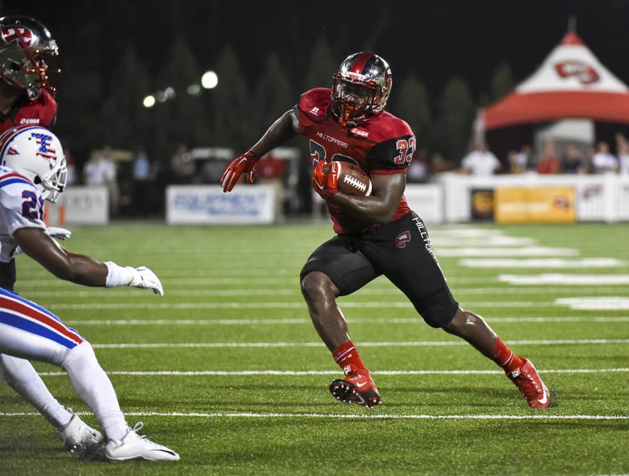 WKU+running+back+Leon+Allen+%2833%29+runs+upfield+during+the+Hilltoppers%E2%80%99+41-38+victory+over+Louisiana+Tech+Thursday+at+Smith+Stadium.+Allen+left+the+game+early+in+the+third+quarter+with+a+knee+injury.+On+Friday%2C+Head+Coach+Jeff+Brohm+released+a+statement+saying+Allen+would+not+return+for+the+rest+of+the+season.+Andrew+Livesay%2FHERALD
