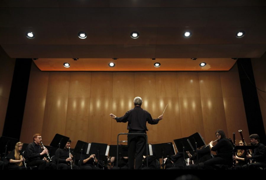 Dr.+Gary+Schallert+conducts+the+wind+ensemble+as+they+close+out+the+show+with+Slavonic+Rhapsody+No.+1+at+the+21st+annual+Prism+concert+Thursday%2C+March+3+at+Van+Meter+Hall.%C2%A0Brook+Joyner%2FHERALD