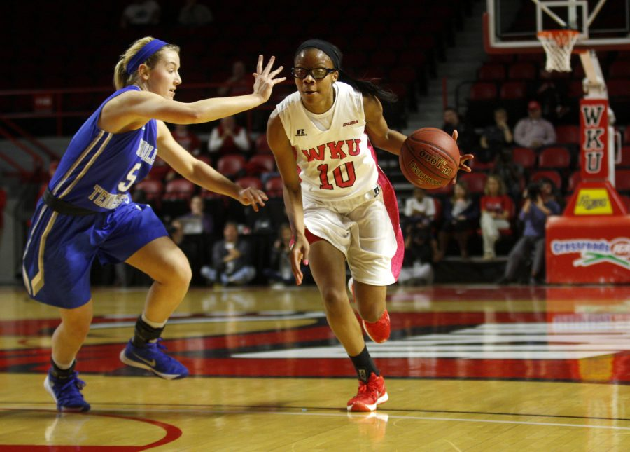 WKU forward Tashia Brown (10) dribbles around MTSU guard Abbey Sissom (5) during the first half of the lady Toppers 32-30 lead over MTSU on Thursday at Diddle Arena.Kathryn Ziesig/HERALD