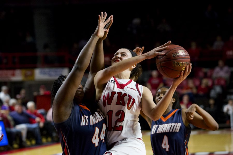 WKU's guard Kendall Noble (12) goes for a layup as Tennessee Martin guard/forward Shy Copney (44) defends during the second round of the WNIT tournament between the Lady Topper and the Tennessee Martin Skyhawks on March 21 at Diddle Arena. Shaban Athuman/HERALD