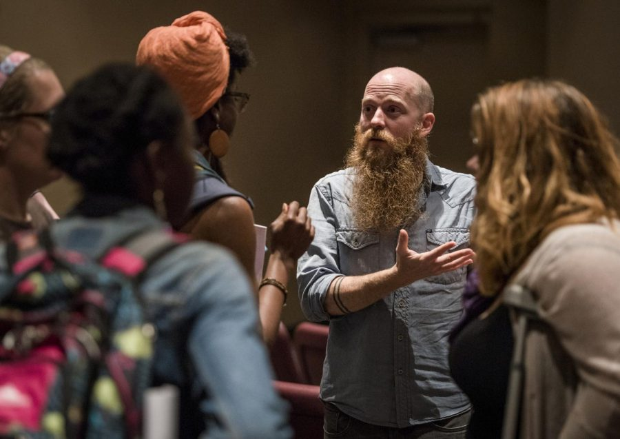 WKU alumnus Chad Stevens speaks with students in the MMTH auditorium following the first viewing of his recent documentary