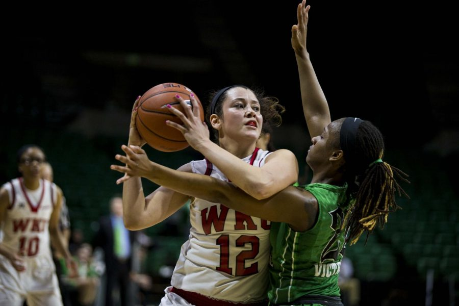 WKU%27s+guard+Kendall+Noble+%2812%29+is+closely+guarded+by+Marshall%27s+guard+Norrisha+Victim+%2820%29+during+the+final+seconds+of+the+Lady+Topper%27s+63-66+loss+in+the+quarterfinals+of+the+C-USA+tournament+Thursday+at+Bartow+Arena+in+Birmingham%2C+Ala.+Mike+Clark%2FHERALD