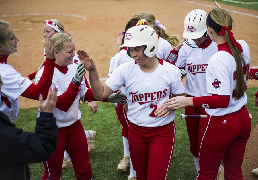 Lake Charles, Louisiana sophomore Carleigh Chaumont is congratulated by the team after hitting a home run, bringing the score to 4-2, WKU winning, in the third inning of the first game in a doubleheader against FIU on Saturday, March 19, 2016. Justin Gilliland/HERALD