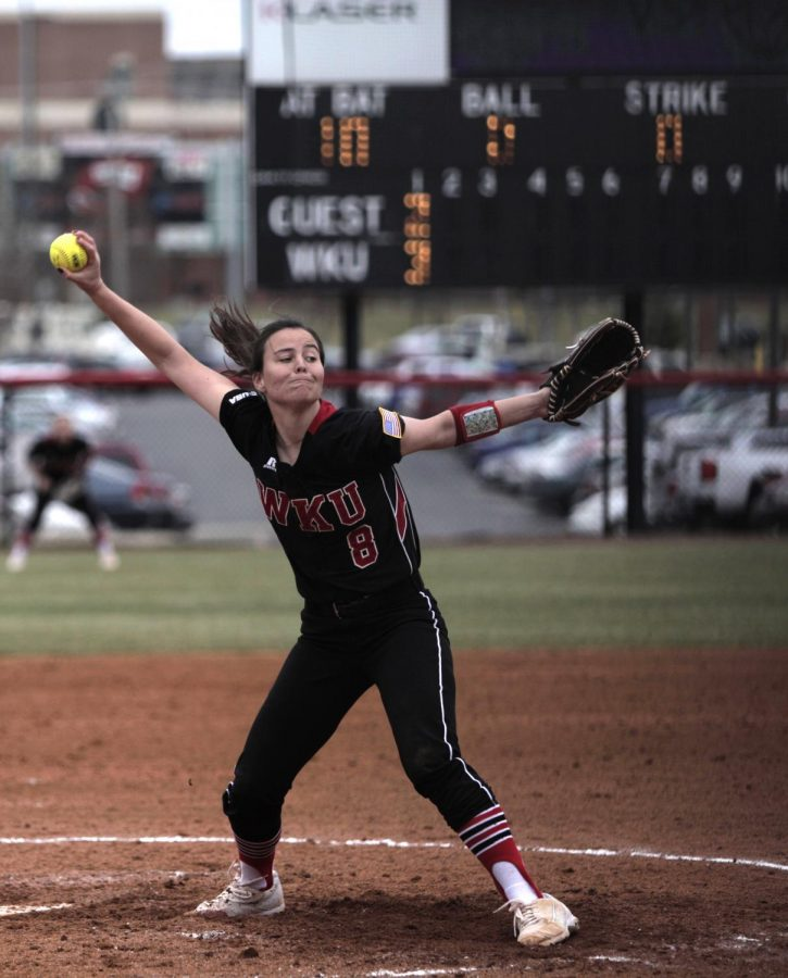 Junior pitcher Kathryn Downing (8) pitches to her opponent during the WKU vs. APSU softball game at the WKU Softball Complex on Friday, Feb. 19. Hilltoppers lost 8-6.Ebony Cox/HERALD