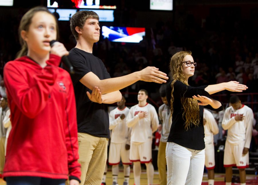 Members of the American Sign Language program sign the National Anthem before the WKU basketball game against Louisiana Tech in Diddle Arena, on March 5. This is a new feature at basketball games and will continue in the future. Jacob Hurdt/HERALD