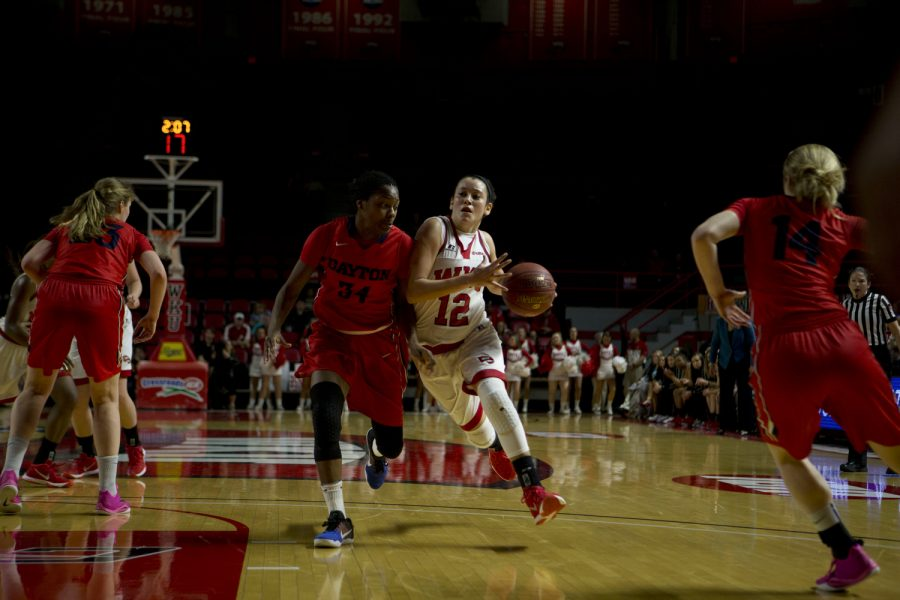 Junior guard Kendall Noble (12) drives towards the hoop during the first half of the game on Thursday.The WKU Lady Toppers basketball team take on the University of Dayton Lady Flyers in the first round of the NIT tournament at Diddle Arena in Bowling Green, Ky on Thursday, Mar. 17, 2016. Matt Lunsford/Herald