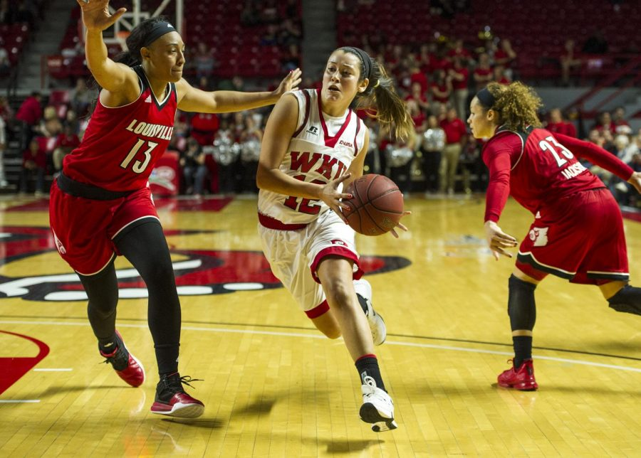 WKU%27s+guard+Kendall+Noble+%2812%29+drives+to+the+basket+past+Louisville+forward+Cortnee+Walton+%2813%29+during+the+Lady+Hilltopper%27s+71-69+win+on+November+21%2C+2015+at+Diddle+Arena.+Nick+Wagner%2FHERALD