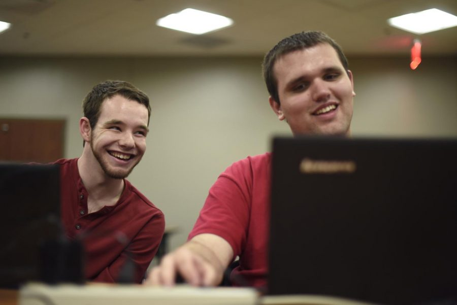 Lexington junior Josh Starnes, 20, jokes with Greenville freshman Jared Latham, 18, during the weekly WKU League of Legends club meeting in Downing Student Union. Abby Potter/HERALD