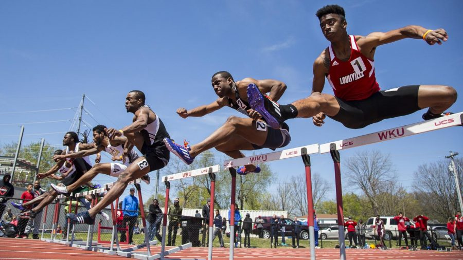 During+the+men%27s+110+meter+hurdles%2C+Martice+Moore%2C+right%2C+a+freshman+at+the+University+of+Louisville%2C+finished+6th+with+the+time+of+14.49+seconds.+Moore+competed+at+the+Hilltopper+Relay+Meet+at+the+Charles+M.+Rueter+Track+and+Field+Complex+on+Saturday.+Weston+Kenney%2FHERALD