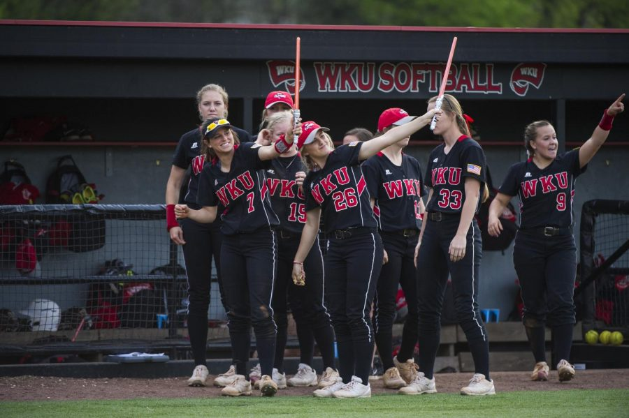 Freshmen infielders Rebekah Engelhardt (7) and Hannah Mabrey (26) point their lightsabers toward a teammate after WKU scored a run during a softball game against Tennessee Tech at the WKU Softball Complex in Bowling Green, Kentucky, on Wednesday, April 13, 2016. The Hilltoppers took down the Golden Eagles 5-3. Nick Wagner/HERALD
