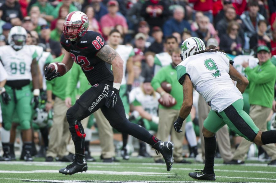WKU's tight end Tyler Higbee (82) runs upfield as Marshall's linebacker Shawn Petty (9) gives chase during the Hilltoppers' 49-28 win on Friday at L.T. Smith Stadium. The Hilltoppers clinched the C-USA East Division championship with the win and will now host the C-USA Football Championship Game on Sat. Dec. 5.